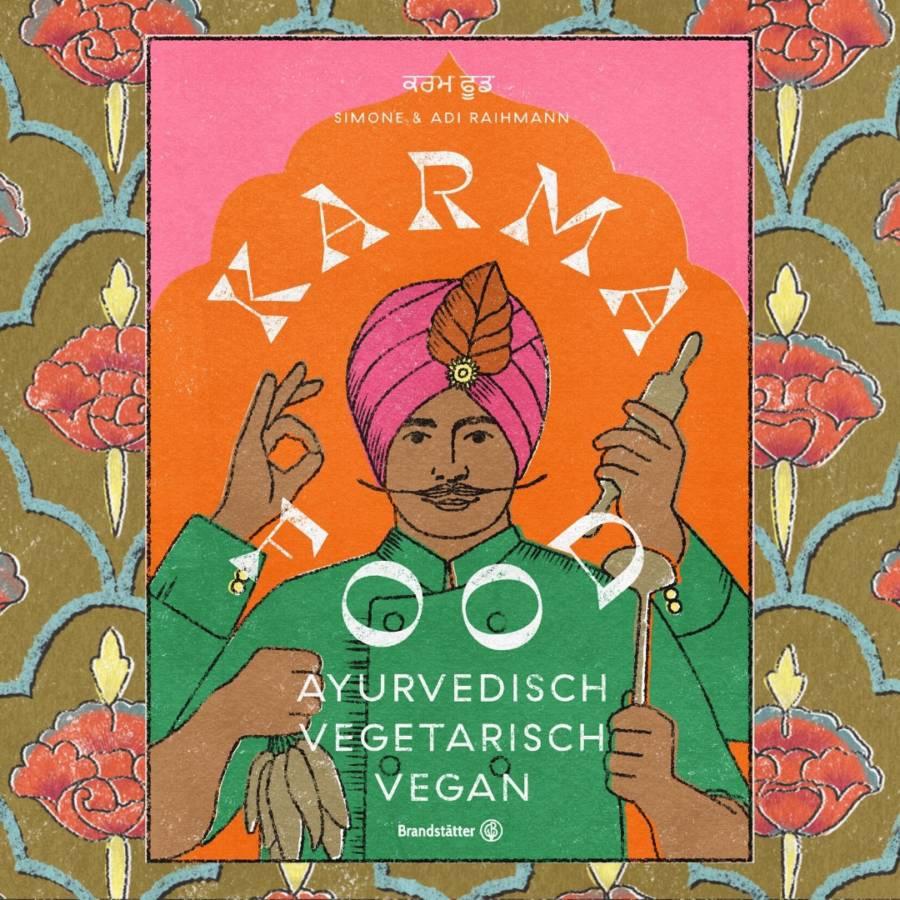 Das Cover vom Karma Food Kochbuch ist sichtbar. Als Text: Autor*innen: Simone und Adi Raihmann. Titel: Karma Food. Ayurvedisch vegetarische vegan. Auf einem rosa/orangenen Hintergrund findet sich ein indischer Mann mit Turban (Daster) und 4 Armen und Händen. In den Händen sind unterschiedliche Kochutensilien wie ein Nudelholz und ein Suppenlöffel, als auch Gewürze. Die ungewöhnliche Anzahl der Hände ist eine Anspielung auf die hinduistische Göttin Durga.